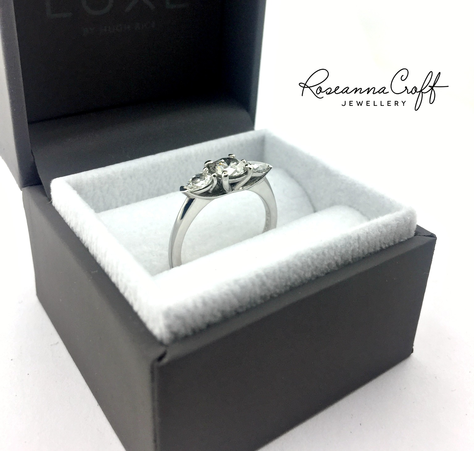 Round and Pear Cut Diamond, Trilogy Engagement Ring by Roseanna Croft Jewellery